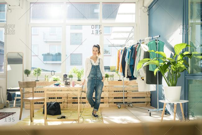 Fashion designer standing in her studio