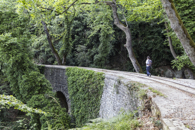 Greece- Pilion- Milies- man walking along rails of Narrow Gauge Railway