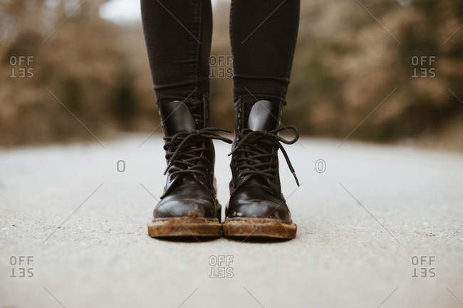 Woman wearing black boots- partial view