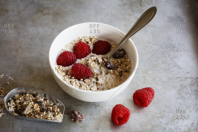 Bowl of homemade granola with raspberries