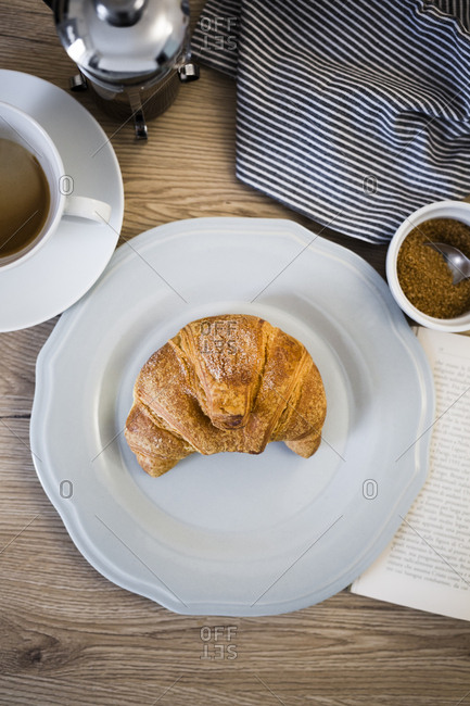 Italian dessert on plate- book- serviette and coffee cup