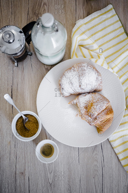Italian desserts with powdered sugar on plate- French press
