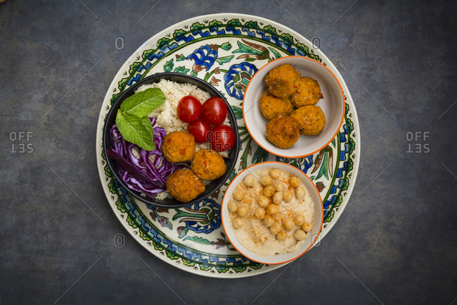 Couscous sweet potato falafel bowl with red cabbage- tomato- mint and hummus
