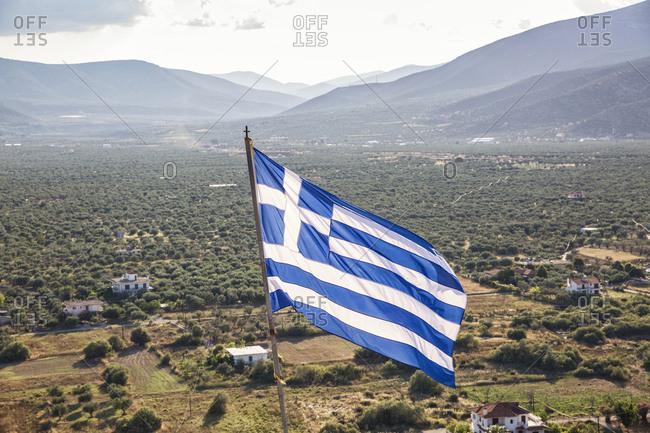 Greece- Peloponnese- Arcadia- Paralia Astros- Flag of Greece- view to fertile plain of Astros