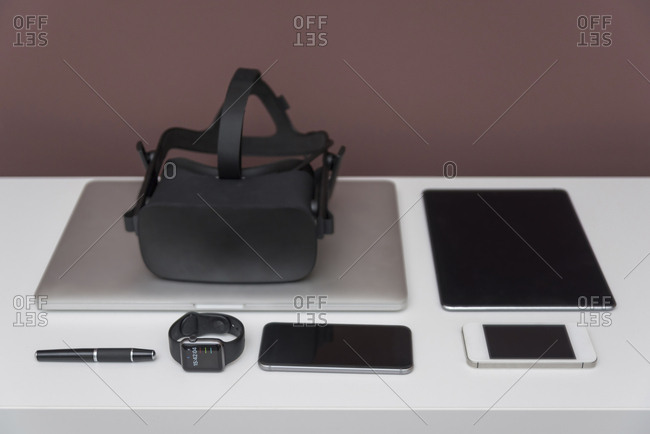 Wearables and mobile devices on dresser