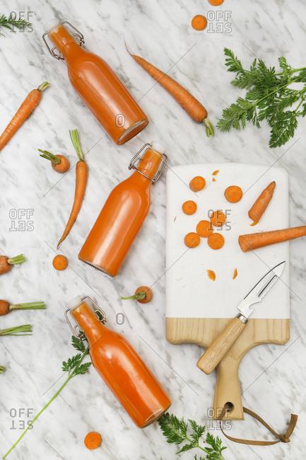 Homemade carrot juice in bottles