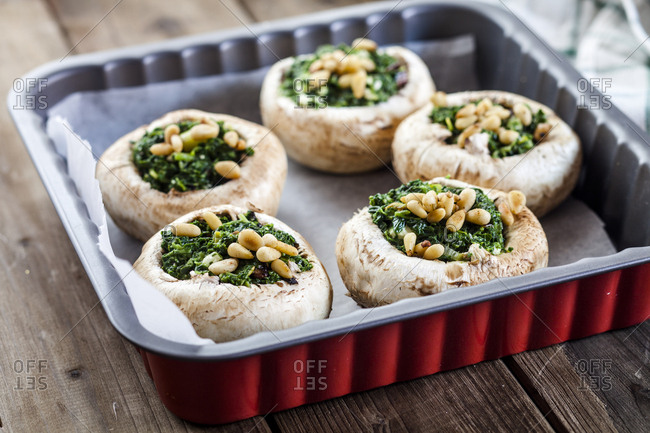Filled champignons with spinach and feta in gratin dish