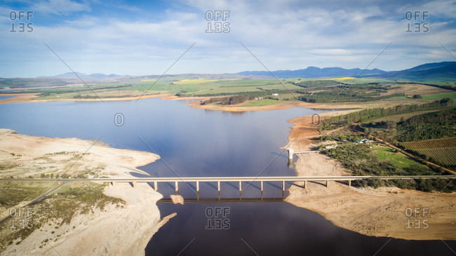 Theewaterskloof dam during the worst drought in decades in the Western Cape of South Africa with massive patches of barren earth exposed