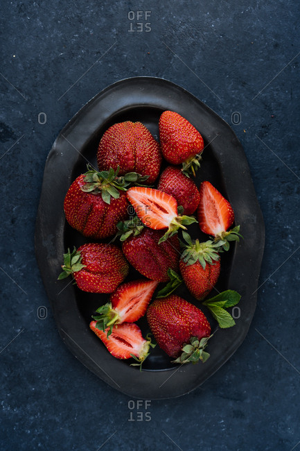 Top down view of platter of large succulent strawberries