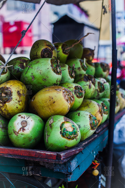 Cart full of fresh green coconuts