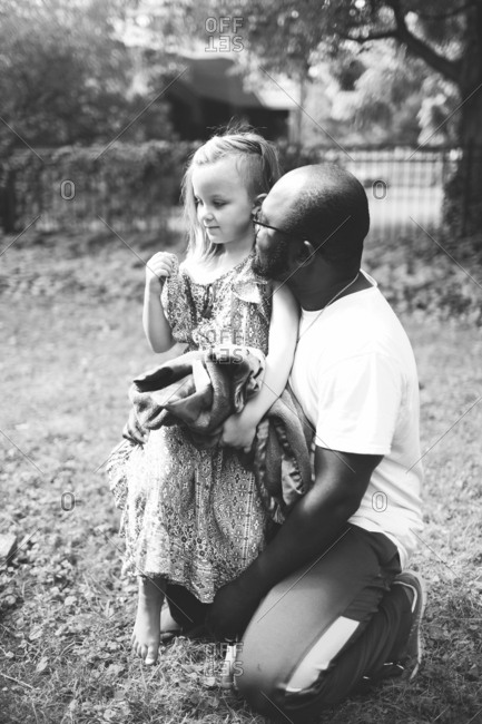 Father holding and looking at his daughter