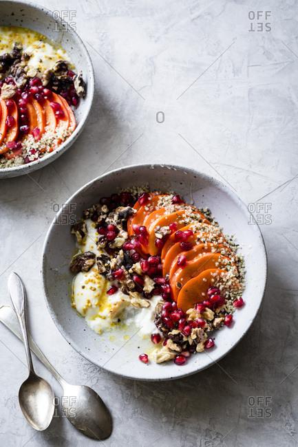 Persimmon pomegranate walnut yogurt bowls