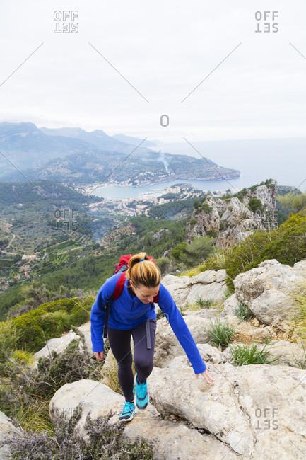 February 14, 2018: Serra de Tramuntura, hiker on a trail above Soller, Majorca, Balearic Islands, Spain, Mediterranean, Europe