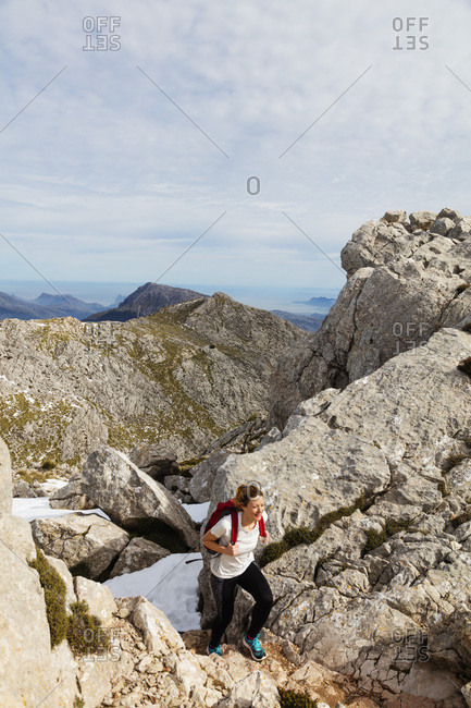 February 16, 2018: Serra de Tramuntura, hiker on Puig de Massanella Mallorca's highest accessible peak, Majorca, Balearic Islands, Spain, Mediterranean, Europe