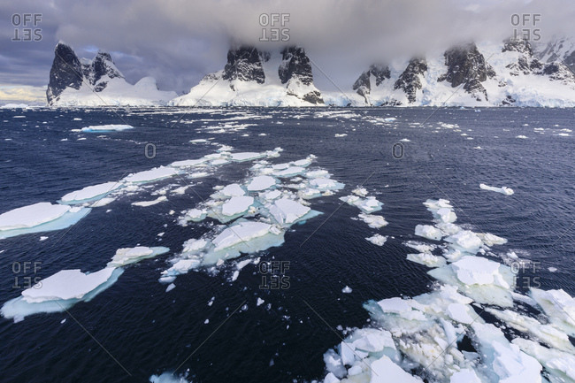 Sea ice off Una Peaks and False Cape Renard, Lemaire Channel entrance, Antarctic Peninsula, Antarctica, Polar Regions