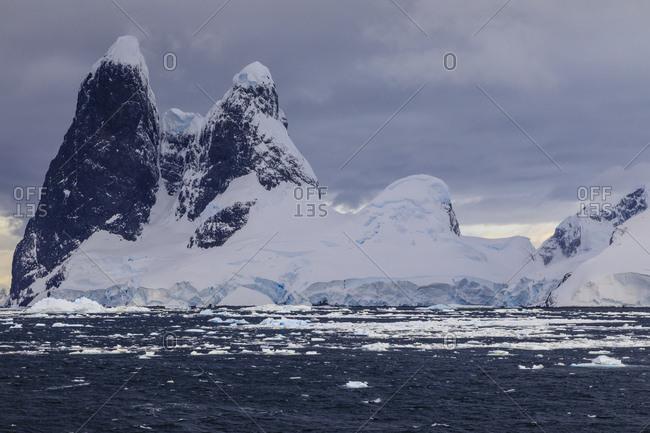 Una Peaks (Una's Tits), basalt ice-capped towers, False Cape Renard, Lemaire Channel entrance, Antarctic Peninsula, Antarctica, Polar Regions