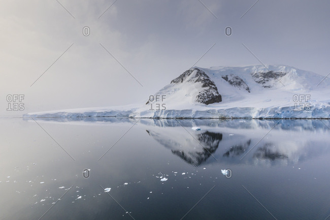 Misty evening reflections, Neumayer Channel between Anvers Island and Wiencke Island, Antarctic Peninsula, Antarctica, Polar Regions