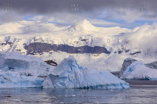 Blue icebergs and mountains, off Cuverville Island, Errera Channel, Danco Coast, Antarctic Peninsula, Antarctica, Polar Regions