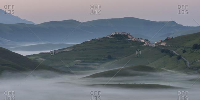 View of the Piano Grande towards Castelluccio, at dawn, Umbria, Italy, Europe