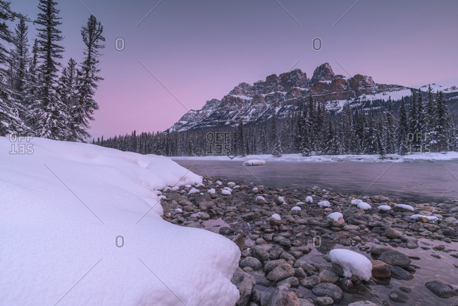 Sunrise and snowy landscape during winter at Bow River and Castle Mountain in Banff National Park, UNESCO World Heritage Site, Alberta, The Rockies, Canada, North America