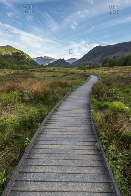 A raised path in the Borrowdale Valley with Castle Crag the prominent hill in the center of image, Lake District National Park, UNESCO World Heritage Site, Cumbria, England, United Kingdom, Europe
