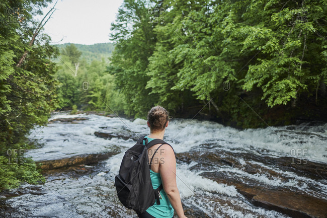 Woman hiker visiting Les Cascades in Mauricie National Park, Shawinigan, Quebec, Canada