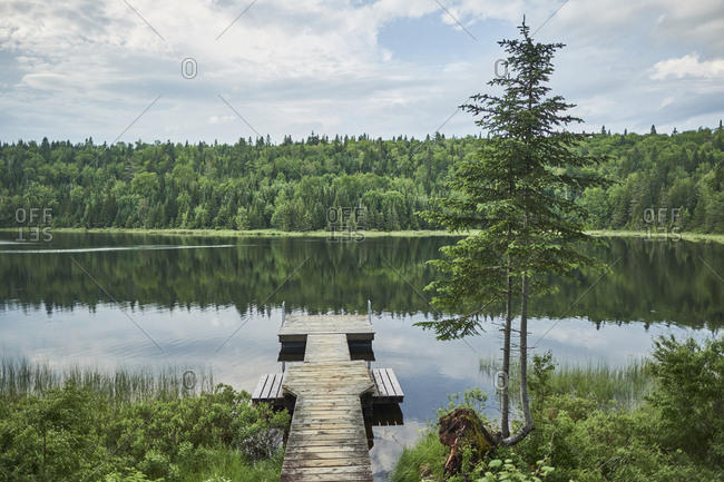 Still lake with dock in Canadian National Park, Shawinigan, Quebec