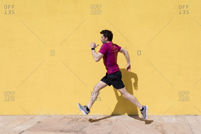Sporty man runs in a urban area, Barcelona, Spain.