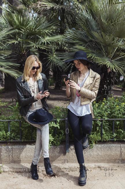 Women using mobile phone outdoor