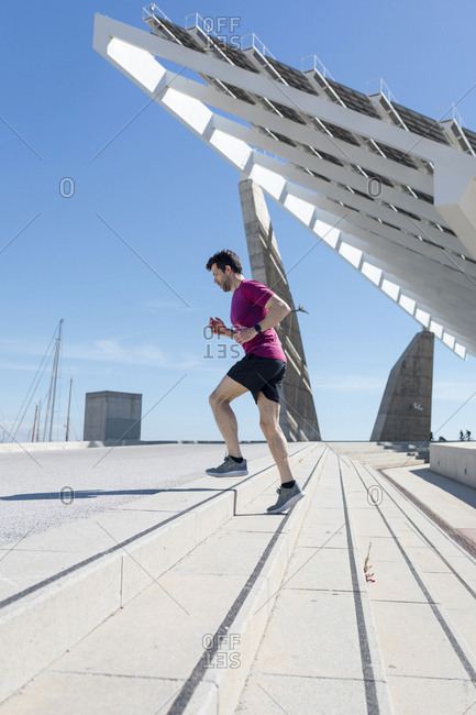 Sporty man doing workout in a urban area, Barcelona, Spain.