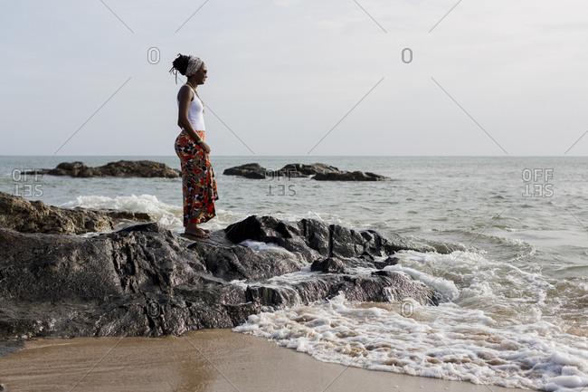 Woman relaxing on a tropical beach. Salvador de Bahia. Brazil.