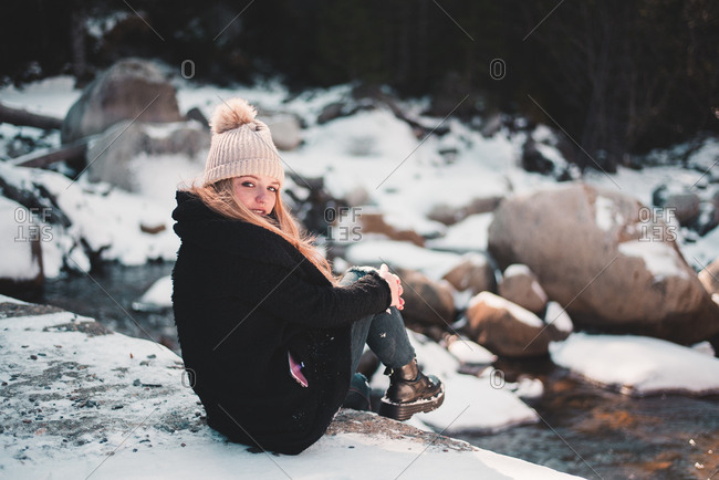 Smiling woman at river in winter