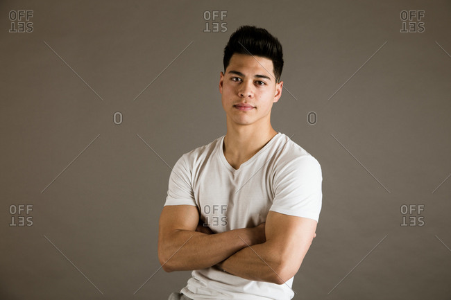 Young man sitting on chair in studio