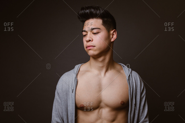 Fit male model posing on dark background
