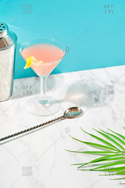 Pink cocktail on colorful background