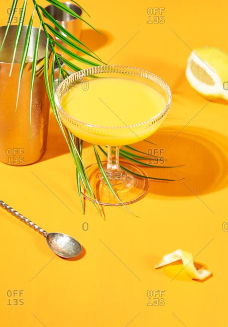 Orange cocktail on orange background