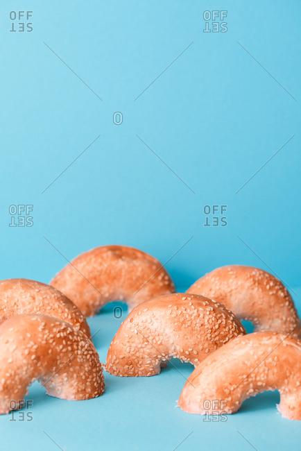 Pink half bagels on blue background