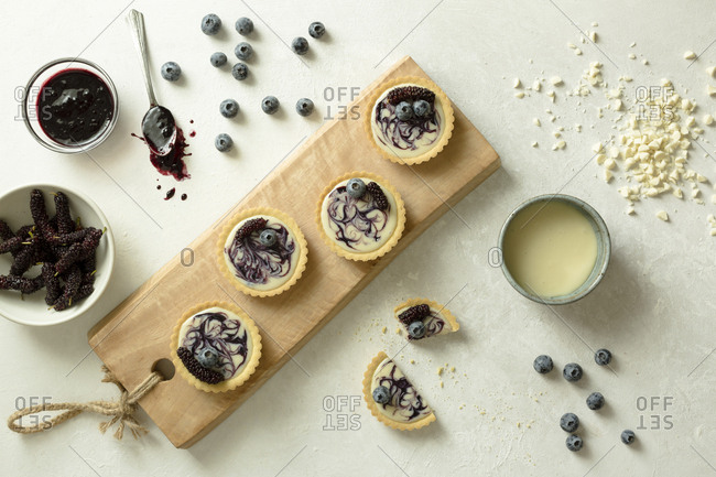 Blueberry and mulberry tarts being made