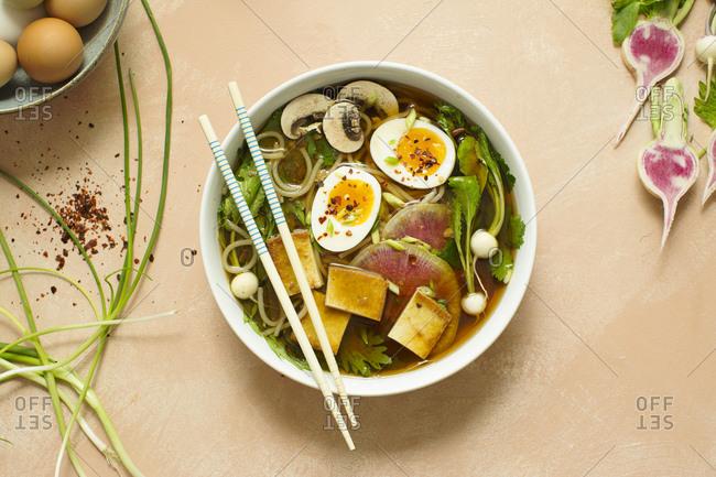 Vietnamese pho noodle soup and chopsticks