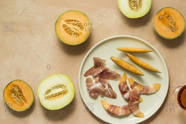 Melon slices wrapped in prosciutto