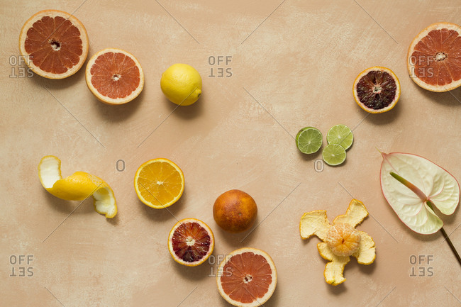 Citrus fruits on a pink background