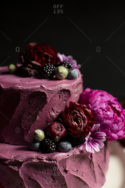Cake with purple frosting and berries