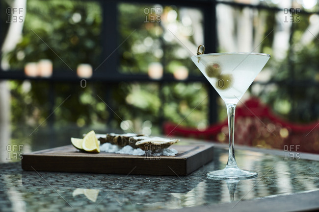 Martini served with raw oysters