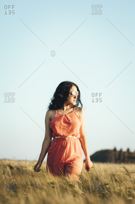 Portrait of a young Arabian girl with sunglasses walking in the countryside