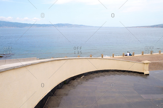 Curved steps leading to coastal promenade