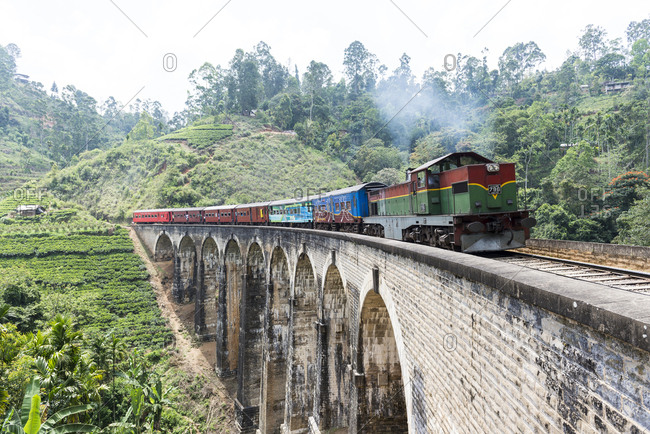 Ella, Sri Lanka - October 5, 2012: Passengers on a train in Ella, Sri Lanka