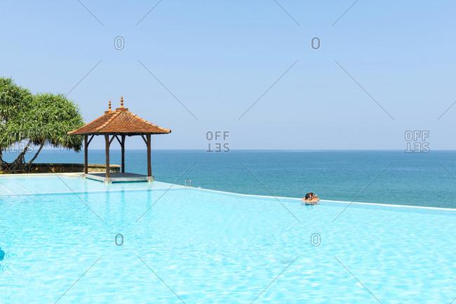 Bentota Beach, Sri Lanka - October 12, 2012: Couple in swimming pool at luxury resort