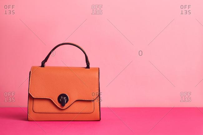 Studio shot of luxury handbag on pink background