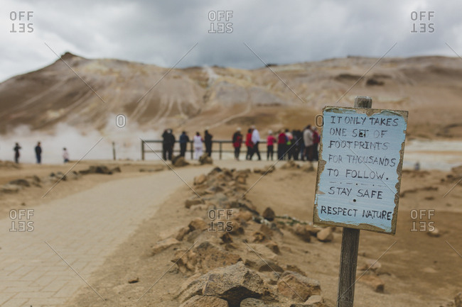 Hand written sign asking visitors to respect nature at the Namaskaro hot sulfuric mud springs in Iceland
