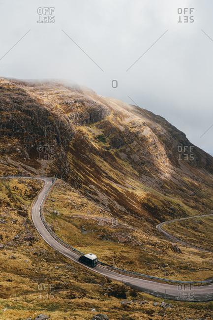 Winding roads on mountainside in rural Scotland